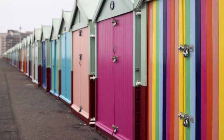 Colourful beach huts on a cloudy day